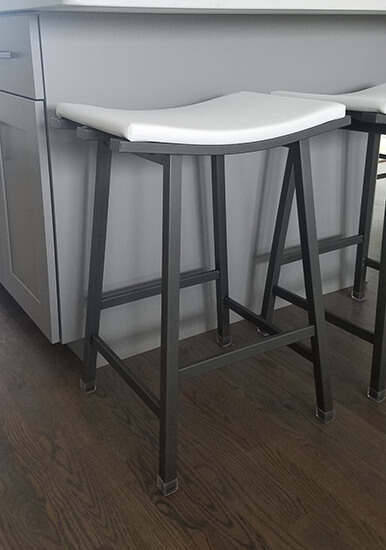 Amisco's Nathan Backless Saddle Stool in Dark Gray and White Vinyl