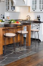 Trica's Laura Swivel Counter Stool with Cross Back Design and Wood Trim on Back, Round Seat Cushion - in Traditional Country Kitchen