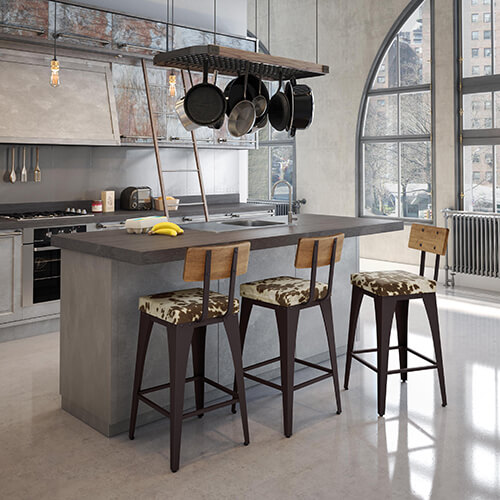 Modern industrial styled kitchen with cowhide upholstery on the bar stools