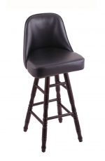 Holland's Grizzly Hardwood Upholstered Swivel Bar Stool with Turned Legs in Dark Cherry, Maple wood finish, and Black vinyl seat and back