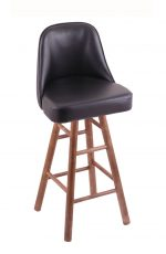 Holland's Grizzly Hardwood Upholstered Swivel Bar Stool in Medium, Maple wood finish, and Black vinyl seat and back