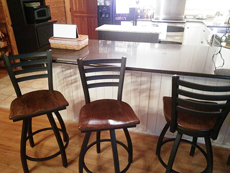 Holland's Jackie Swivel Bar Stool in Kitchen with Black Finish and Brown Seat