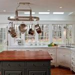 Mount a Hanging Pot Rack in Traditional White and Brown Kitchen