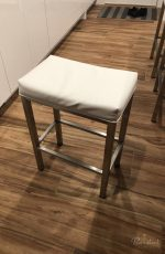 Wesley Allen's Seattle Backless Saddle Modern Barstool in Stainless Steel with White Vinyl