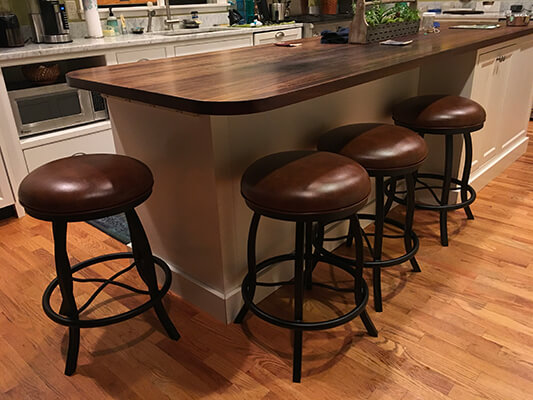 Customer Photo: Callee's Americana Backless Swivel Barstools in Modern White Kitchen with Brown Hardwood Flooring