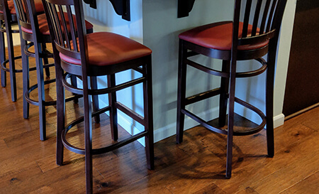 Holland's 3120 Hampton Wooden Stationary Barstool with Vertical Slats on Back and Seat Cushion in Customer Kitchen