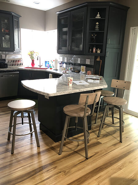 Amisco's Architect Swivel Barstools with Wood Seats and Metal Frame in Transitional Kitchen