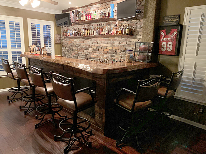 Callee's Texas Tilt Swivel Stools with Arms in Traditional Mancave with Bar
