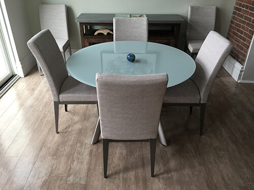 Amisco's Alto Upholstered Dining Chairs in Dining Room with Glass Top Table and Hardwood Flooring