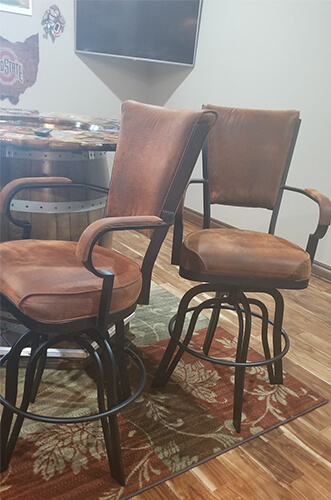 Lisa Furniture's #2545 Tilt Swivel Stools with Arms in Customer's Bar in Brown and Black