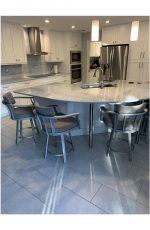 Callee's Kingston Upholstered Swivel Nickel Bar Stool with Arms in Customer's Transitional White Kitchen