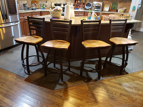 Holland's #410 Jackie Swivel Stools with Ladder Back and Maple Medium Seat Wood Finish in Traditional Kitchen