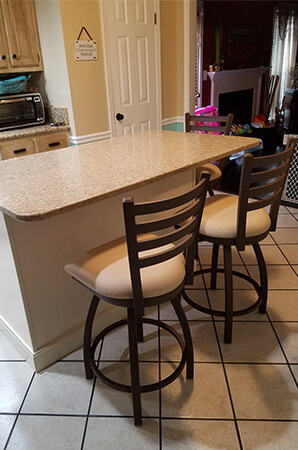 Holland's Jackie Swivel Counter Stools in Traditional Brown/Tan Kitchen with Tile Flooring and Kitchen Island