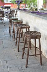 Woodard's Casa Backless Swivel Bar Stools in Aluminum Brown Finish Near Outdoor Bar - 4 Backless Stools Shown