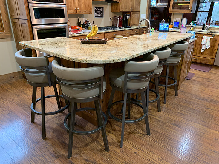 Wesley Allen's Miramar Upholstered Swivel Bar Stools with Low Back in Traditional Large Kitchen