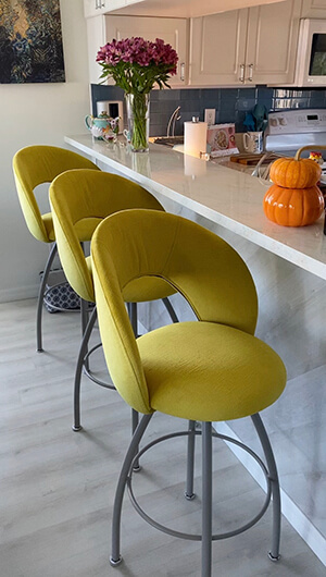 Trica's Biscotti Swivel Kitchen Counter Stool in Yellow Upholstery and Gray Base Metal Finish