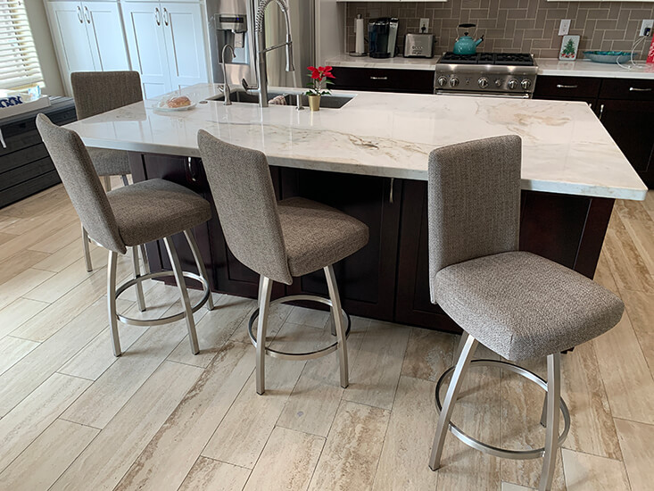 Trica's Nicholas Swivel Counter Stools in Brushed Steel and Tan Upholstery in Modern Kitchen
