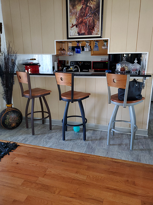 Holland's Voltaire Swivel Wood Metal Barstool in Traditional Kitchen