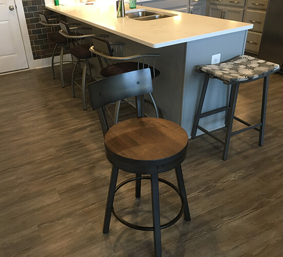 Amisco's Lauren Swivel Bar Stools with Metal Back and Wood Seat in Kitchen