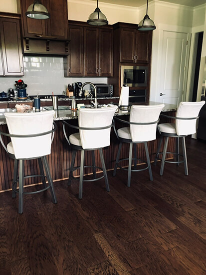 Amisco's Cardin Swivel Counter Bar Stools with Arms in Gray Metal Finish and White Seat Cushion in Traditional Kitchen