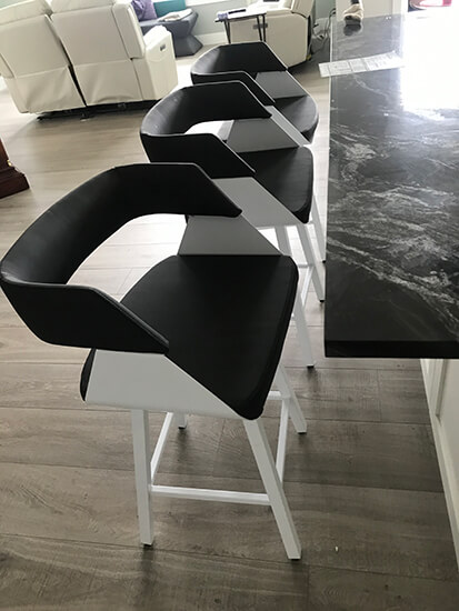 Amisco's Stacy Modern Swivel Bar Stools with Arms in White Metal Finish and Black Upholstery