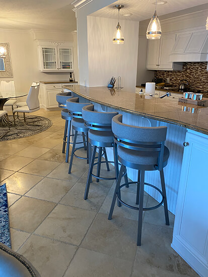 Amisco's Ronny Swivel Bar Stools in Silver Metal Finish and Fabric in Modern Kitchen