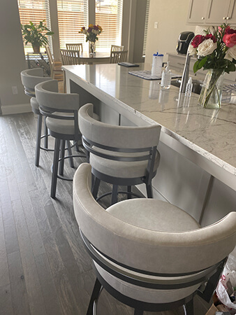 Amisco's Ronny Gray Swivel Bar Stools in Modern Kitchen
