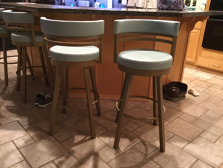 Amisco's Ronny Swivel Bar Stools in Gold Metal and Seafoam Green Cushion in Kitchen