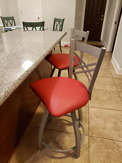 Holland's Catalina XL Swivel Counter Stools with Cross-Back Design and Red Seat in Kitchen