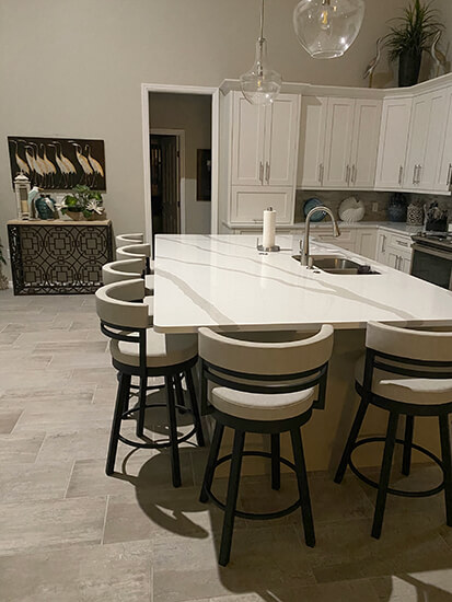 Amisco's Ronny Swivel Counter Stools in Black Metal Finish and Light Gray Fabric in Large Modern Kitchen