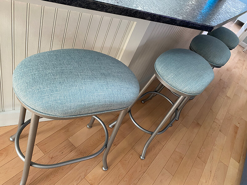 Wesley Allen's Canton Modern Backless Oval Swivel Stools in Silver Metal and Blue Seat Cushion in Kitchen