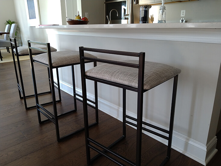Amisco's Sonoma Modern Brown Metal Barstool with Low Back and Fabric Cushion in Modern Kitchen