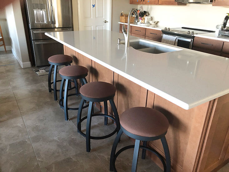 Holland's Misha Backless Swivel Stools in Black Metal Finish and Brown Fabric in Traditional Kitchen