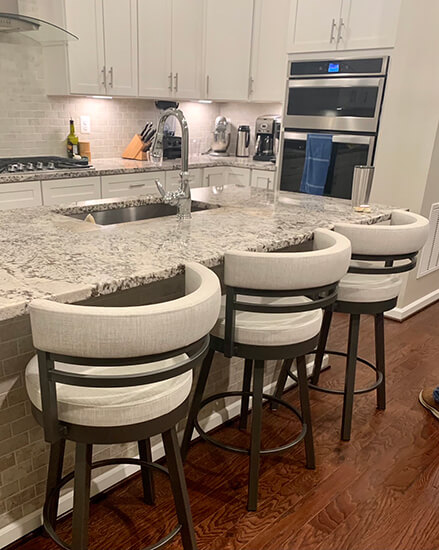 Amisco's Ronny Swivel Counter Stools in Gray and Cream in Modern Kitchen