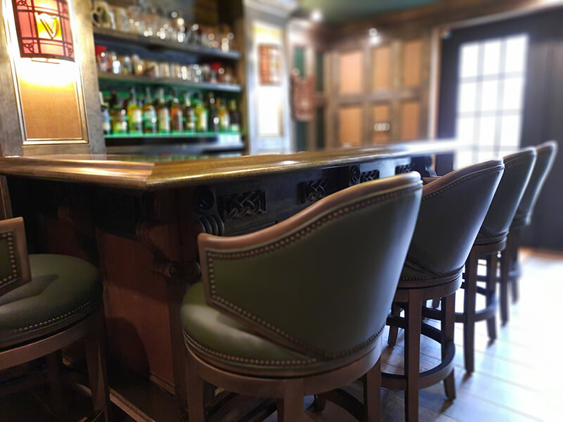 Fairfield's Gimlet Upholstered Swivel Bar Stool with Curved Back in Green and Brown in Home Bar
