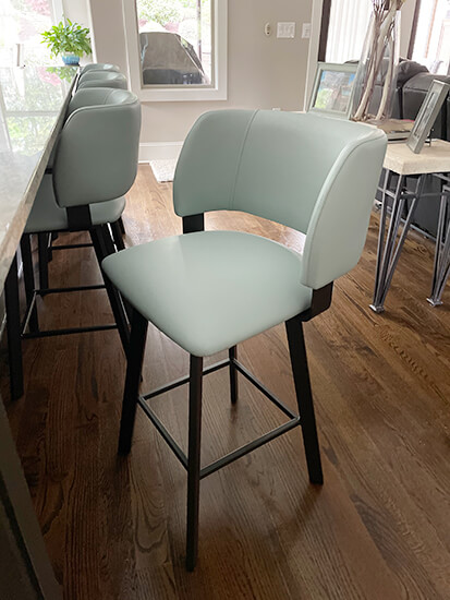 Amisco's Easton Dark Brown Swivel Counter Stools with Seafoam Green Seat and Back in Modern Kitchen