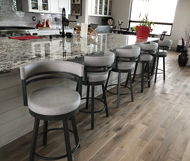Amisco's Ronny Gray Swivel Counter Stools with Gray Seat Cushion in Modern Kitchen