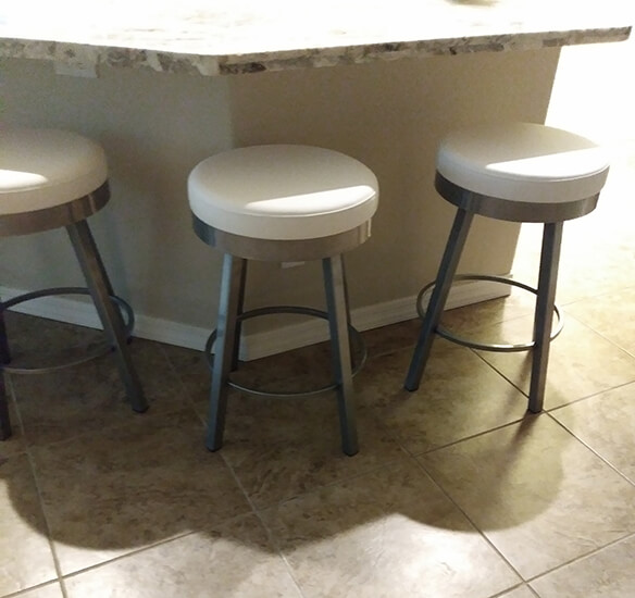 Amisco's Rudy Backless Swivel Counter Stools in Silver and White in Kitchen