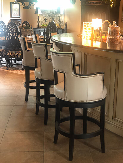 Fairfield's Sidecar Luxury Wood Swivel Bar Stools Upholstered in Cream and Black Wood Finish in Traditional Kitchen