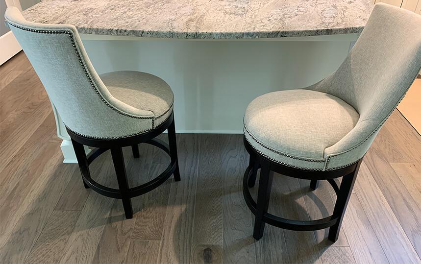 Fairfield's Vesper Upholstered Wood Swivel Stool in Linen Fabric, Nailhead Trim, and Espresso Wood in Customer Kitchen