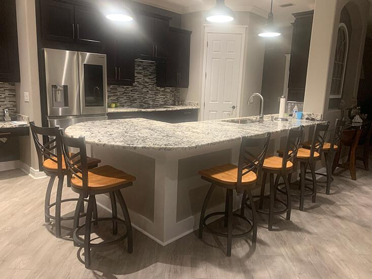 Holland's Catalina Swivel Counter Stools in Dark Gray Metal and Oak Medium Wood Finish in Modern Kitchen