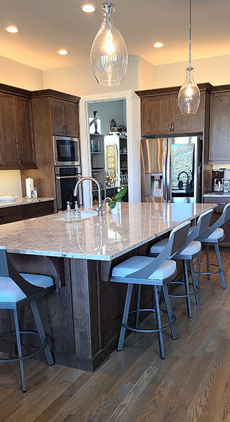 Amisco's Fame Modern Swivel Bar Stools in Dark Gray Metal and Gray Fabric in Modern Kitchen