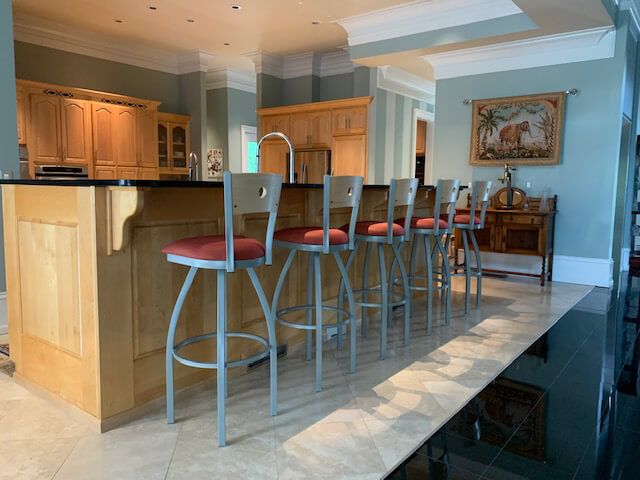 Holland's Voltaire Traditional Nickel Swivel Bar Stool with Wood Back in Customer's Traditional Kitchen with Wood Cabinets
