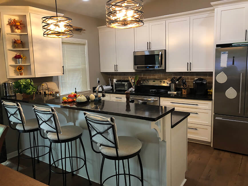 Trica's Bill Transitional Swivel Bar Stools in Modern White and Black Kitchen