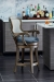 Fairfield's Melrose Upholstered Swivel Wooden Barstool with Curved Arms, in Multiple Fabrics, Shown in Brown Wood Finish, Displayed in Modern Kitchen