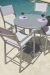 Woodard Palm Coast All-Weather Bar Stools with Table Near Pool