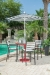 Woodard's Palm Coast Barstools Outside Near Pool with Pub Table