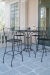 Woodard's Aurora Bar Stools on Patio with Table
