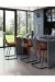 Amisco's Cassidy Modern Bar Stool with Sled Base in Dark Modern Kitchen
