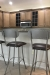 Amisco's Bean Swivel Bar Stools with Seat Cushion and Back - in Transitional Brown Kitchen with Stainless Steel Appliances